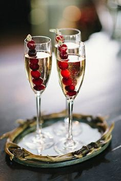 use frozen cranberries to keep champagne cold