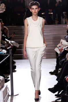 SPRING 2013 COUTURE  Bouchra Jarrar /   Flowers and romance have emerged as major themes at the Spring Haute Couture shows. Not for Bouchra Jarrar. She's not averse to seduction, but she does have a serious sensibility—urban, unfussy, even (that dreaded word) practical, but all the while chic.