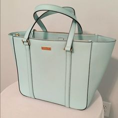 """Kate Spade Newbury Lane Briar Tote - PRICE FIRM Condition is like new, only used a couple of times and stayed stored in dust bag. Bottom of bag has very very small black dots (see pics). Comes with dust bag! Height: 11.5"""" Strap Drop: 8.5"""" Bottom Width: 13"""" Depth: 6.25"""" Color: Cyblue Material: Saffiano Leather Offers only accepted through offer button kate spade Bags Totes"""