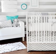 If you are afraid to commit to a color for your baby's nursery, try a neutral approach with accents of color. I discovered this beautiful nursery on Project Nursery's blog when I was searching for chevron bedding for a friend. All of the key pieces are neutral while some of the accents are bold, pops of color. The combination of grey and white provide a nice, soft hue perfect for a unisex nursery.