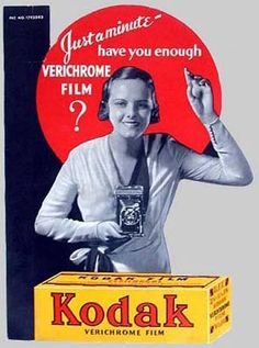 This counter card from the 1940s shows a Kodak Girl reminding shoppers to buy film.