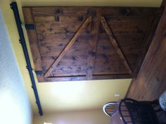 Homemade sliding barn door.  Doors can be used horizontal vs vertical, add trim to piece them together.