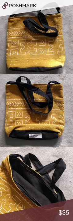 African Mudcloth Zipper Tote Bag Carry your belongings in the cultural style of Africa. This mudcloth hand bag is handcrafted with hand painted authentic mudcloth. The zip top gives your extra convenience so you don't worry about things spilling put out of your bag Bags Totes