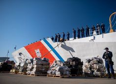The crew of the Coast Guard Cutter Munro gather in formation behind seized contraband during a drug offload in Alameda, California. The crew was responsible for nine interdictions, seizing approximately 10,200 pounds of cocaine and 11,450 pounds of marijuana. Alameda California, Coast Guard Cutter, 200 Pounds, Drugs, Military, Military Man, Army