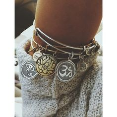 Mix and match the gold and silver Alex & Ani bangles like this wearer for a cool vibe #AlexandAni
