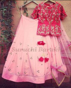 Lovely combination of colors and style. Rich and heavy handwork peplum top with minimalistic skirt by Suruchi Parakh (Mix Match Saree) Choli Designs, Lehenga Designs, Saree Blouse Designs, Blouse Patterns, Blouse Styles, Indian Attire, Indian Wear, Indian Dresses, Indian Outfits