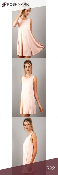 Perfect Everyday Swing Dress Great everyday wardrobe staple piece. Solid Sleeveless knit Swing dress.  96% RAYON 4% SPANDEX  Runs true to Size  MADE IN THE USA Dresses Mini