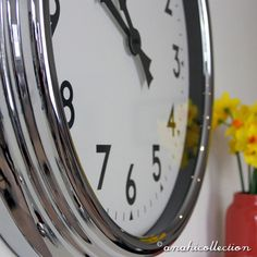 LARGE CHROME WALL CLOCK Designed in Britain, this gorgeous statement 60 cm diameter wall #clock in a high quality metal chrome case will grace your kitchen, hall or living room wall. #ANAHICollection #living #interiordesign #interiors