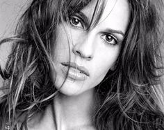 Hilary Swank...She can play just about any kind of role