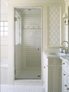 All white tiled bathroom.