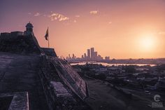 Sunset Over Colombian City of Cartagena Captured from Castillo San Felipe de Barajas Colombian Cities, Concrete Jungle, Urban Photography, Open Up, Cityscapes, Photographic Prints, Sunsets, Colonial, Climbing
