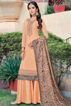 Exquisitely embroidered with hand & machine work, this light orange georgette sharara suit which will give a very sassy look. This v neck and full sleeve attire embellished in stone work. Along with santoon sharara pants in light orange color with light orange georgette dupatta. Sharara pants are plain. Dupatta elaborated using stone and thread work. #shararasuits #malaysia #Indianwear #weddingwear #andaazfashion Indian Attire, Indian Wear, Light Orange, Orange Color, Orange Party, Pantalon Cigarette, Sharara Suit, Wear Store, Costume