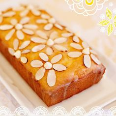 "This Lemon-Almond Pound Cake is SO delicious and easy to make! I added ""almond flowers"" on top for a sweet finish. Get the details on the blog today: blog.hwtm.com #dessert #seizethekrusteaz #bohochic #flowerpower"