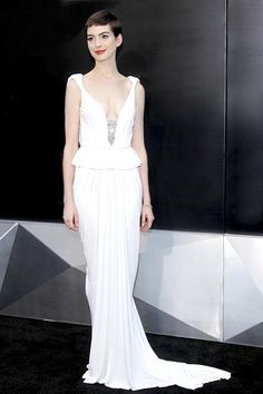 Anne Hathaway is gorgeous in a white peplum gown
