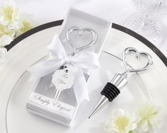 Heart Bottle Stopper Wedding Favors.  It's a good idea to mix and match so couples get two different ones.