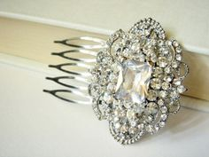 The prettiest hair comb ever! Sparkling clear crystals are set around a large emerald cut cubic zircon stone. Set on an antique silver tone comb for total feminine style.   I also have a matching bracelet available here, http://romanticbrides.storenvy.com/products/344197-vichy-art-deco-vintage-...