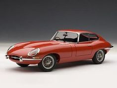 This Jaguar E Type Series I Coupe Diecast Model Car is Red and features working steering, suspension, wheels and also opening bonnet with engine, boot, doors. It is made by AUTOart and is scale (approx. Jaguar Xk, Jaguar E Type, Autoart Diecast, Jaguar Models, Jada Toys, Diecast Model Cars, Concept Cars, Cool Toys, Scale Models