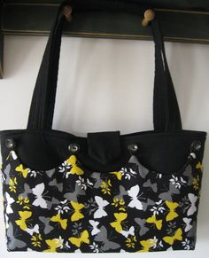 http://www.etsy.com/listing/91760452/butterflies-and-buttercups-reversable