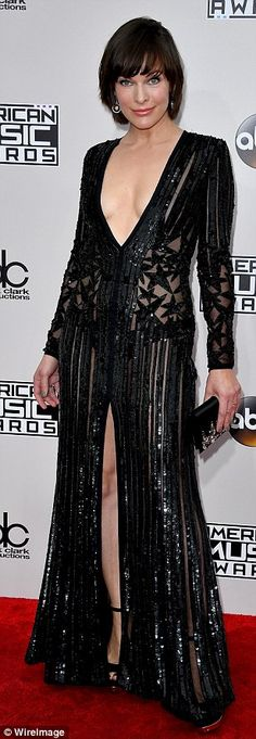 Sparkling! Milla Jovovich wowed in a plunging black gown with centre slit...