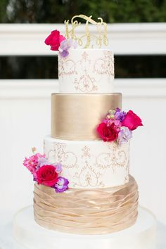 Wow this chic purple, gold and pink cake is absolutely stunning, from the intricate detail to the beautiful flowers #wedding #cake #beautiful #stunning #pink