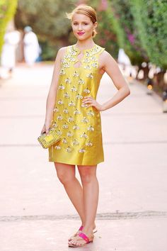 Yellow embellished shift paired with hot pink sandals.