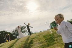 Bubble fun at weddings. This photo was taken a at country wedding in Dorset.    Alternative, fun and reportage wedding photography by Dorset wedding photographer and photojournalist.