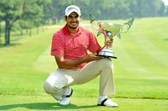 of India poses with the winner's trophy on Monday. Golf Tour, India, Poses, Running, Figure Poses, Racing, Delhi India, Keep Running, Jogging