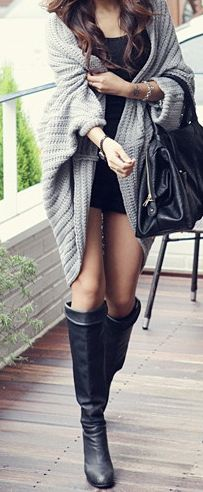 Oversized cardigan with black top and bottom. The boots are very casual and classy.