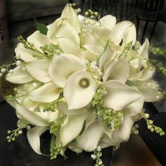 Calla lily and lily of the valley bouquet! I'd want this with burgundy calla lillies instead of white
