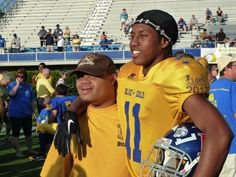 A player and his buddy - the essence of the DFRC Blue-Gold All-Star Football Game.