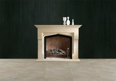 THE SHELBURNE MANTEL An imposing stone Tudor mantel of unusual form incorporating heavy jambs which are shaped to project forwards at the midpoint. Shown here in English Bathstone. Please note: The standard production material for this fire surround is Bianco Avorio priced as indicated.
