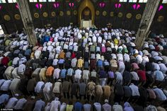 Thai Muslims attend a mass prayer during the Eid al-Fitr holy celebrations at a large mosque in Bangkok, Thailand, earlier this morning