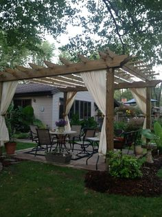 Absolutely love pergolas but LOVE the idea of adding curtains to help with bugs and add softness!