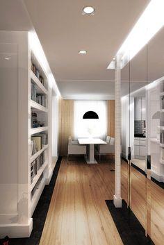 Wystrój wnętrz eleganckiego apartamentu w klasycznym stylu - Tissu. Stylowy apartament wykończony z przewagą czerni i bieli, z elegancką biblioteką w salonie. http://www.tissu.com.pl/zdjecia/386