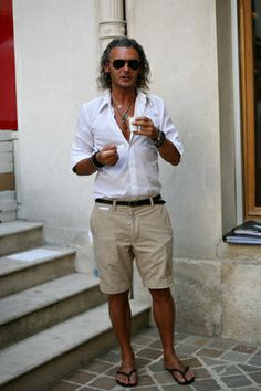 Tan shorts, white shirt