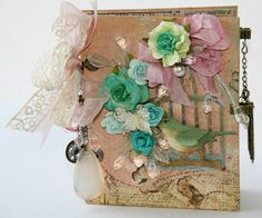 hot glue flowers, birds & more onto a journal for a great hand made gift