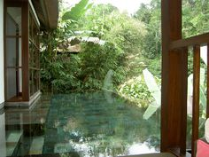 Ubud Hotel & Resort - I love how you can't easily tell where the building ends and the waters starts or the water ends and the plants start. Also the colour and stillness is divine.