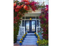 Pretty porch entry - stairs - Dark blue door - bougainvillea trellis - beachy - Marco Island Doors - Florida