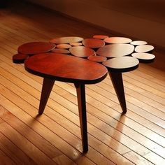 I am completely head over heels in love with Michael Arras' Circles Coffee Table. He's put a sophisticated and original twist on a Danish Modern classic, a furniture equation that I constantly crave for my own home…