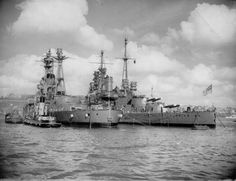 October 15, 1946: HMS Resolution and HMS Valiant on the River Tamar in Devonport, England. Note Resolution has had the guns removed.