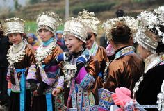 Traditionally dressed women of Miao ethnic group take part in the 'Pohui', a big party event participated by local people to celebrate Chinese lunar new year, in Yuanbao Village of Antai Township, Rongshui Miao Autonomous County, south China's Guangxi Zhuang Autonomous Region, Feb. 10, 2014. The 'Pohui', which has a history of more than 100 years, is annually held from the first day to the 17th day of the first month on the Chinese lunar calendar. (Xinhua/Li Bin)