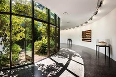 Twenty-five feet below the sprawling front lawn of the Tennessee governor's mansion sits a spectacularly luminous underground event venue. The Archimania-designed sunken courtyard is the crown jewel of the project.