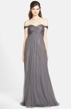 Love the off the shoulder sleeves of this gorgeous bridesmaid dress