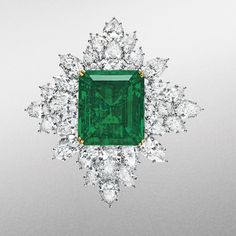 Harry Winston gold and pear-cut diamond brooch, with a central rectangular-cut emerald, weighing 42.88 carats. Circa 1971. Estimate: $700,000 - $1,000,000
