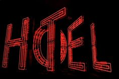 neon HOTEL indicator built from recycled signs by artist Tom Fruin