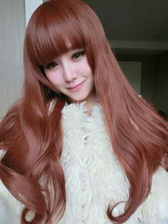 Reddish-peachy hair color- craving this color!