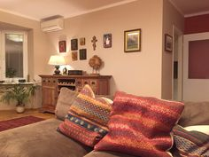 Serbian family home in Moscow. wooden table, sofa, living room, wood, deko