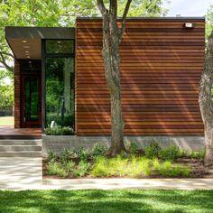 Un.Box Studio creates compact waterfront cottage in Austin woods