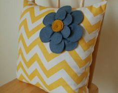 Grey flowers on bright chevron background. That works.