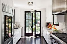 Like these black French Doors -- (from a Hollywood Hills Home : Architectural Digest) Architectural Digest, Home Design, Interior Design, Interior Doors, Kitchen Interior, Design Ideas, Interior Ideas, Design Projects, Design Trends